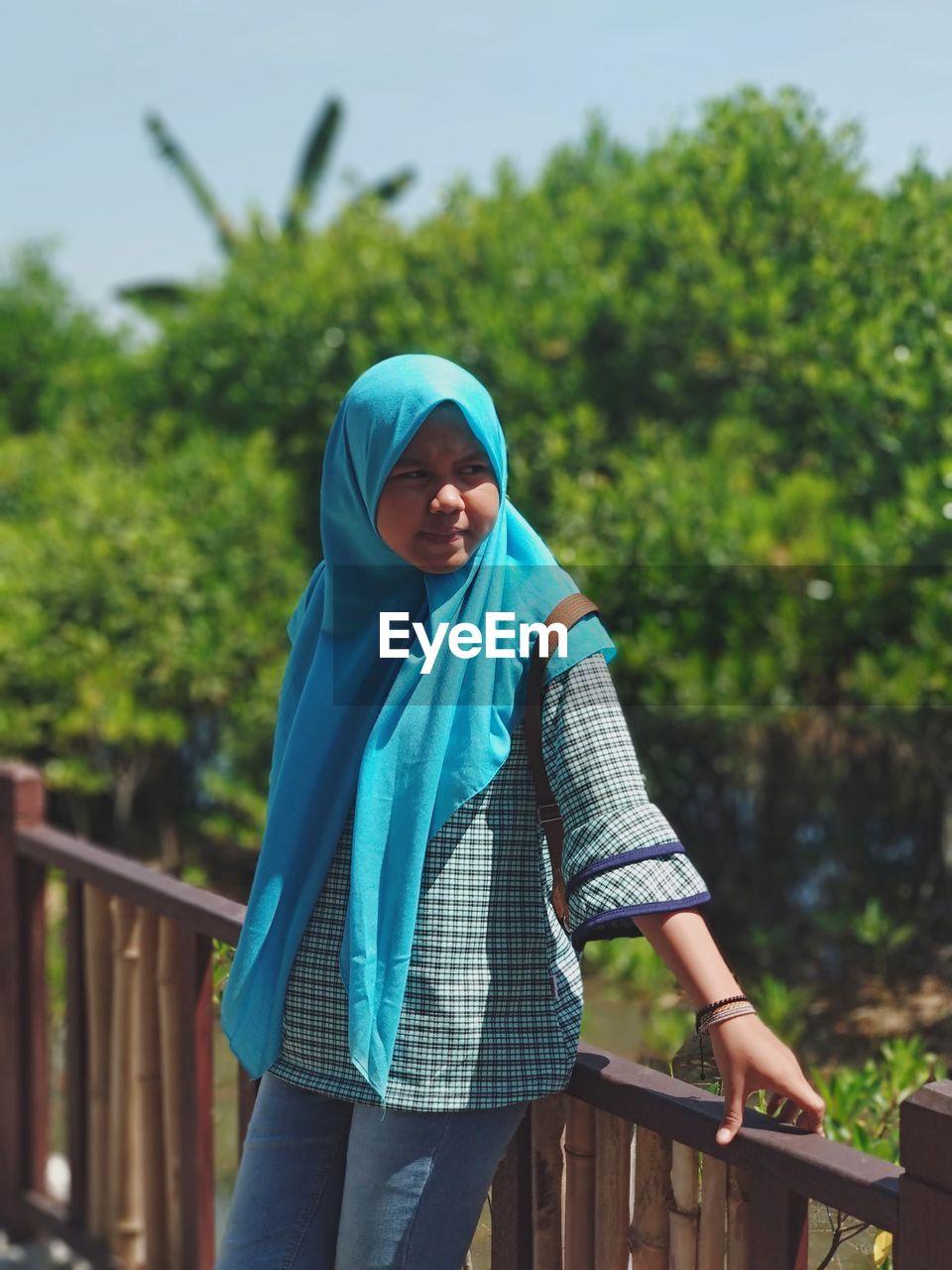Teenage Girl Wearing Hijab While Leaning On Railing