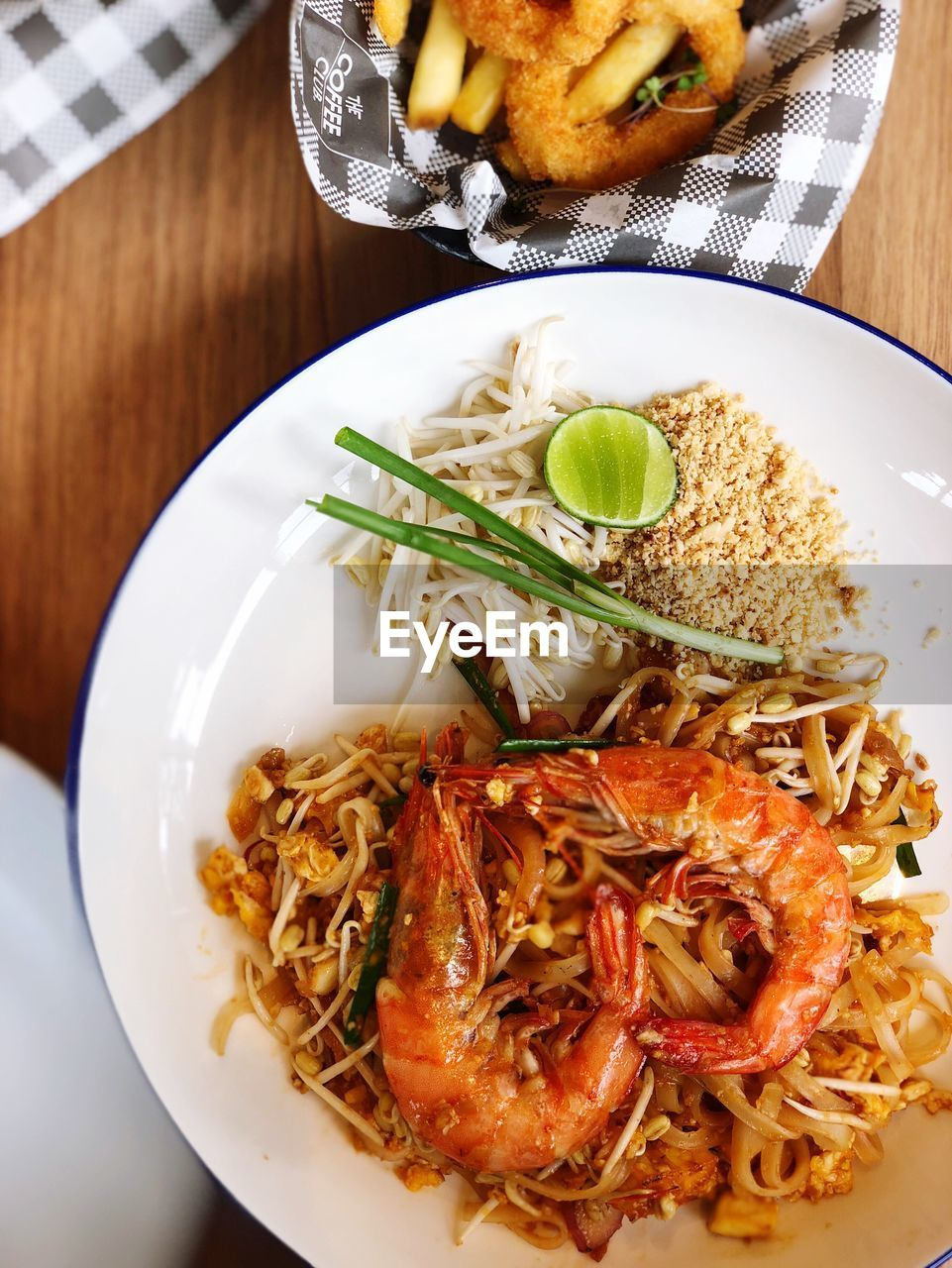 food, food and drink, ready-to-eat, freshness, plate, pasta, table, serving size, healthy eating, italian food, seafood, wellbeing, indoors, close-up, meal, no people, high angle view, still life, crustacean, shrimp - seafood, dinner, spaghetti, garnish, temptation, crockery