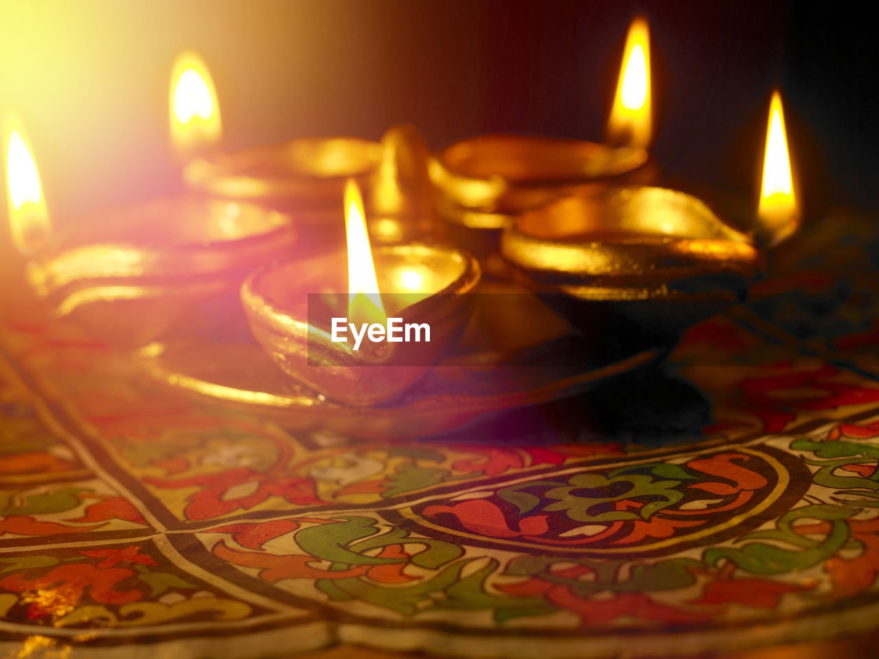 flame, burning, candle, celebration, diya - oil lamp, oil lamp, illuminated, indoors, heat - temperature, glowing, diwali, no people, lighting equipment, tea light, selective focus, traditional festival, close-up, tradition, table, night