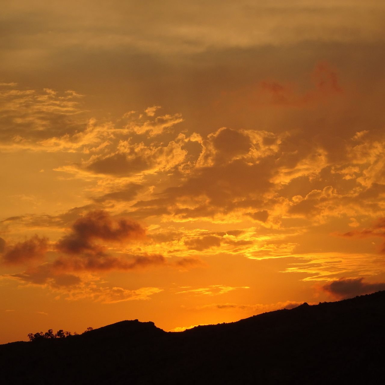 sunset, sky, cloud - sky, beauty in nature, orange color, scenics - nature, silhouette, tranquil scene, tranquility, idyllic, nature, non-urban scene, no people, dramatic sky, environment, low angle view, outdoors, mountain, landscape, awe