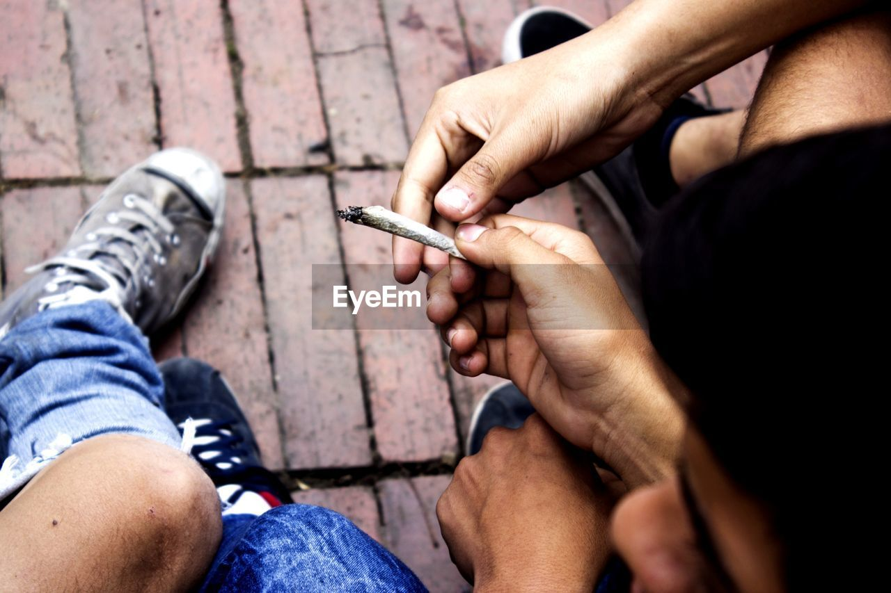 cigarette, real people, men, bad habit, smoking issues, social issues, human hand, lifestyles, narcotic, human body part, hand, people, holding, smoking - activity, recreational drug, tobacco product, marijuana - herbal cannabis, marijuana joint