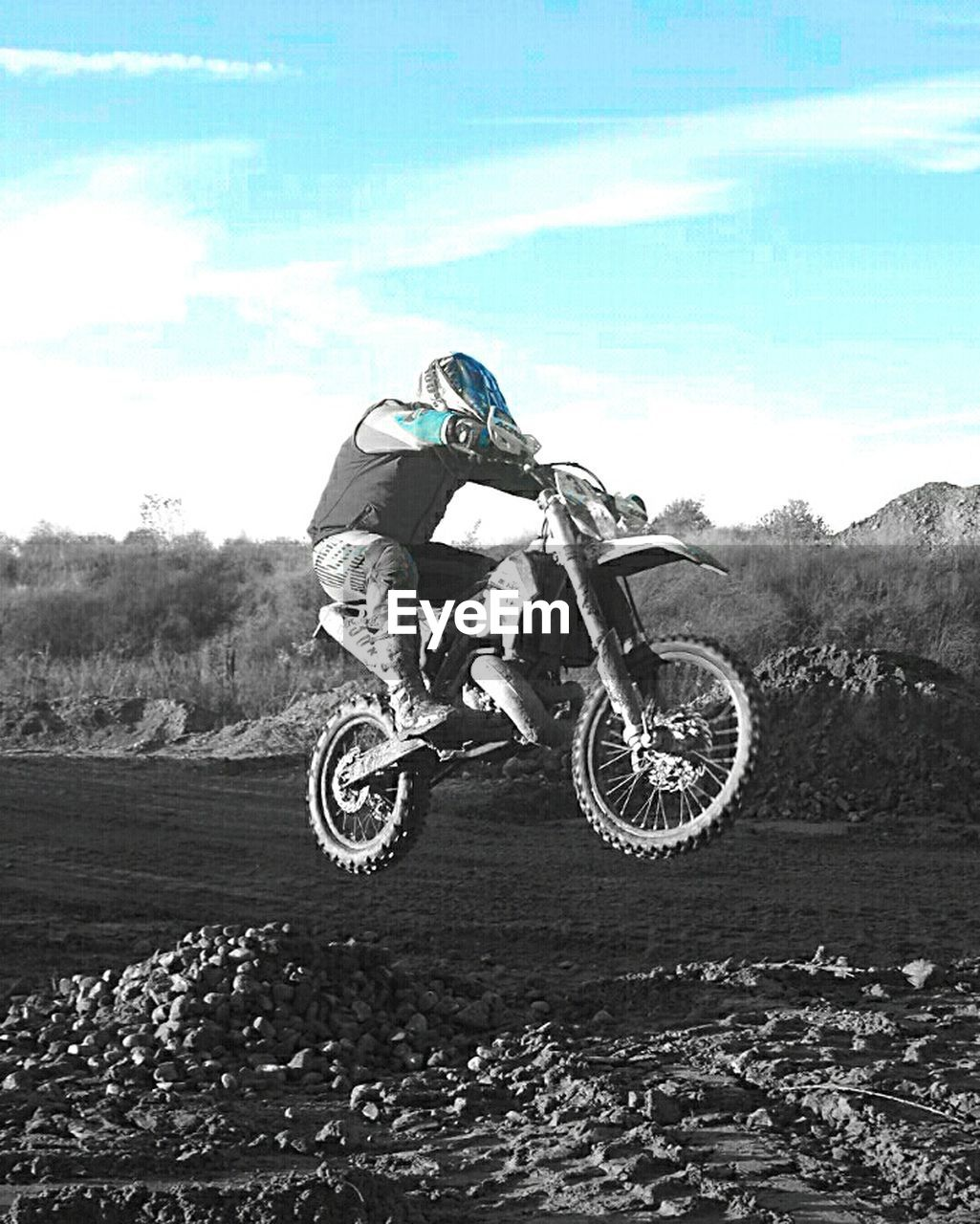 extreme sports, sport, motocross, adventure, motorcycle, speed, control, motorsport, stunt, helmet, riding, transportation, full length, sky, crash helmet, motorcycle racing, risk, skill, sports race, sports helmet, competition, day, men, jumping, one person, headwear, competitive sport, real people, outdoors, sports clothing, sports track, biker, people