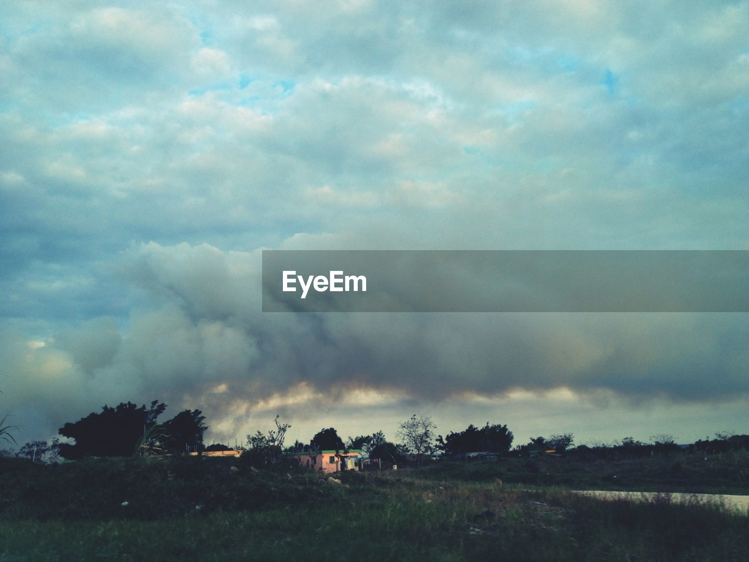 sky, cloud - sky, cloudy, landscape, field, tranquil scene, tranquility, weather, scenics, beauty in nature, nature, overcast, storm cloud, grass, cloud, tree, dusk, dramatic sky, rural scene, idyllic