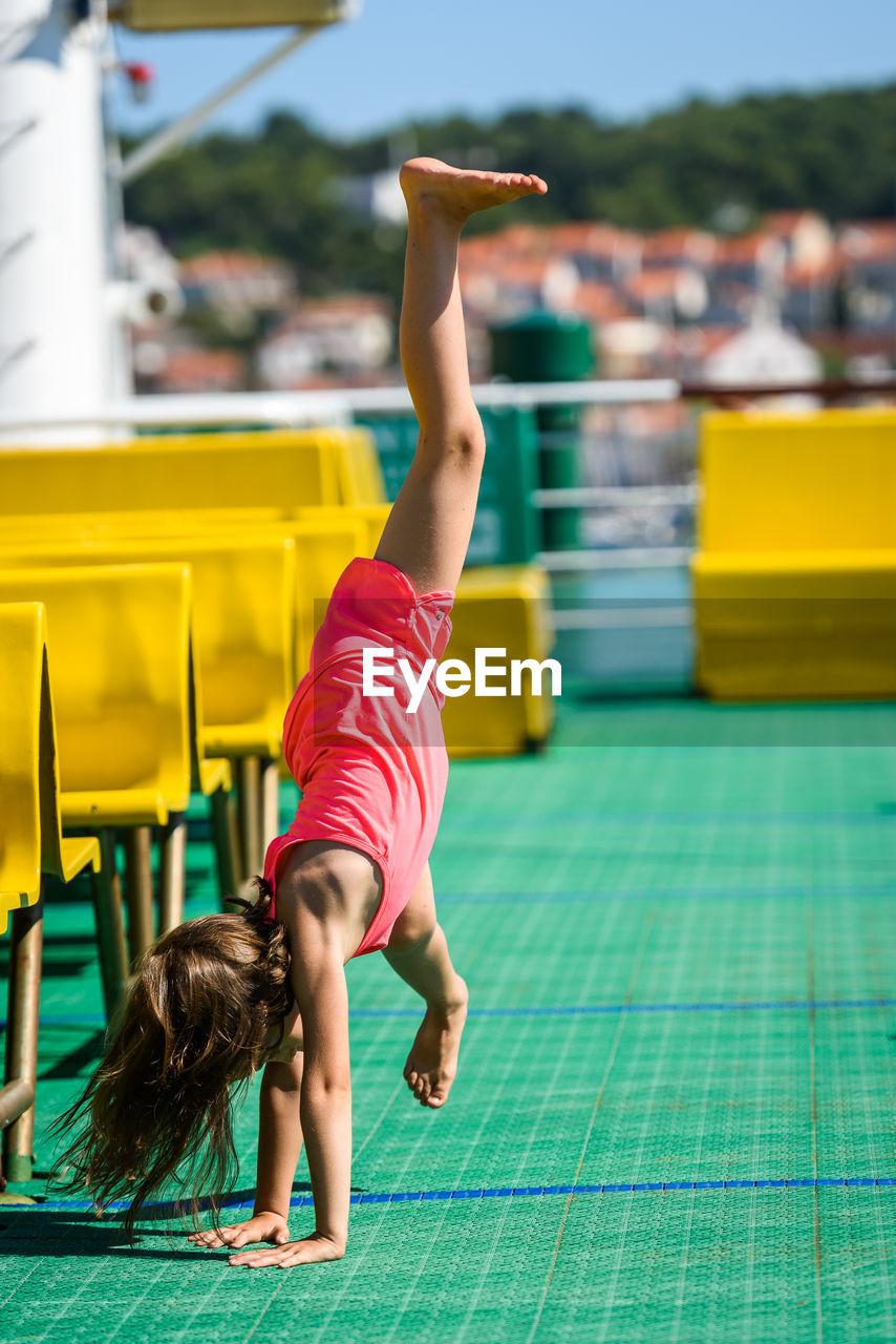 Girl Doing Stunt In Boat