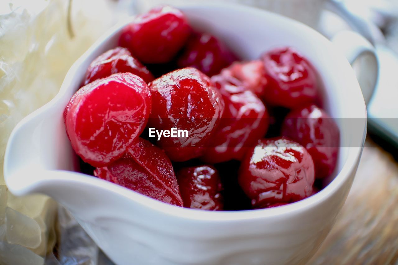CLOSE-UP OF STRAWBERRIES IN BOWL WITH FRUITS