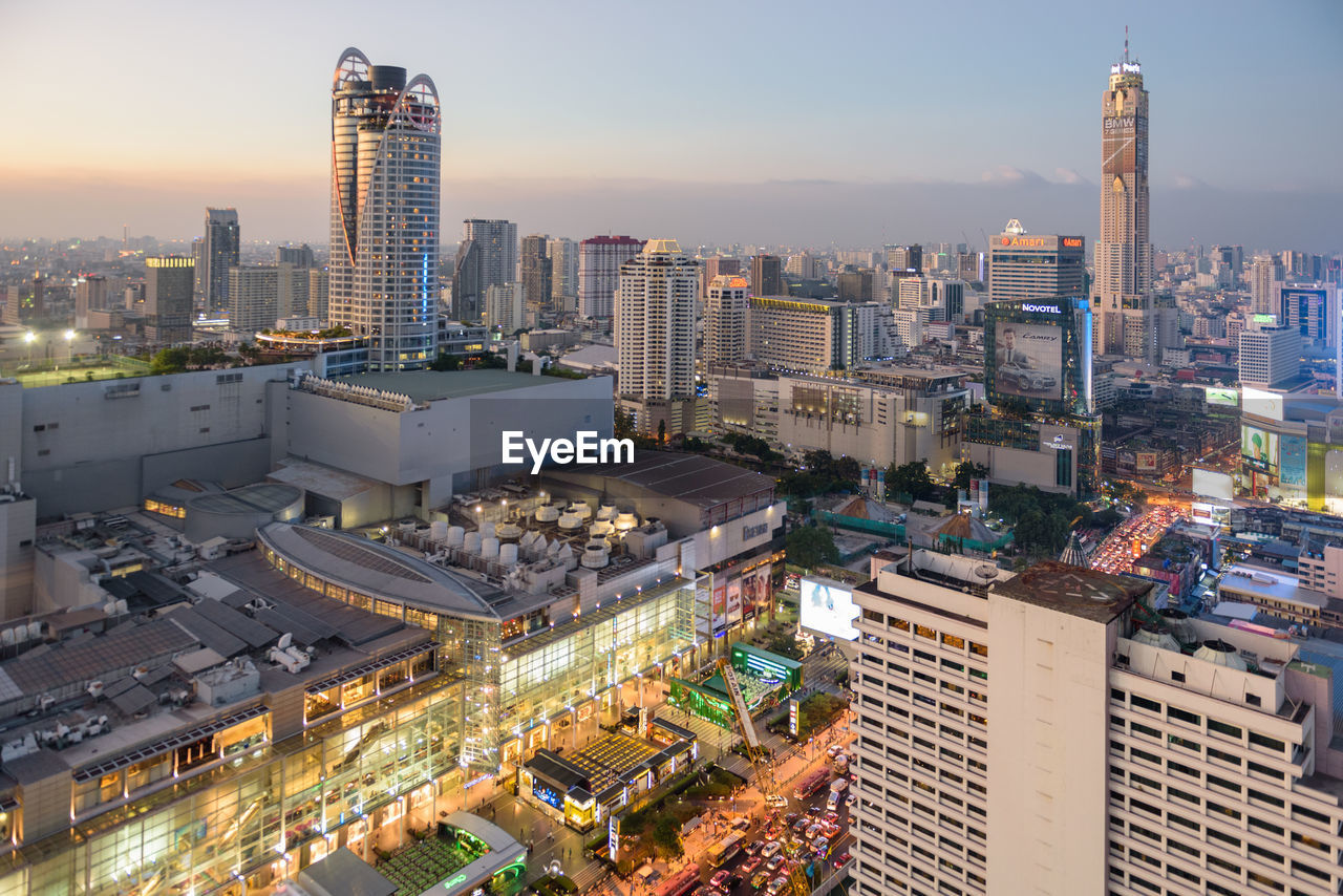 cityscape, architecture, skyscraper, building exterior, city, illuminated, high angle view, no people, built structure, outdoors, urban skyline, sky, day