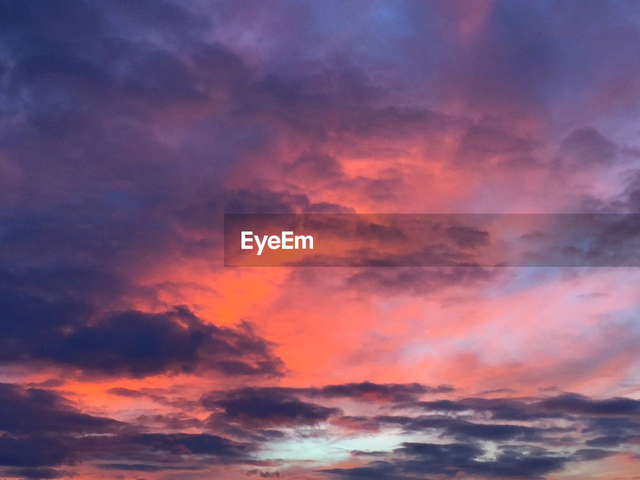 sunset, beauty in nature, nature, scenics, sky, dramatic sky, cloud - sky, tranquil scene, majestic, tranquility, orange color, cloudscape, idyllic, low angle view, weather, sky only, no people, multi colored, backgrounds, outdoors, environment, awe, storm cloud, day