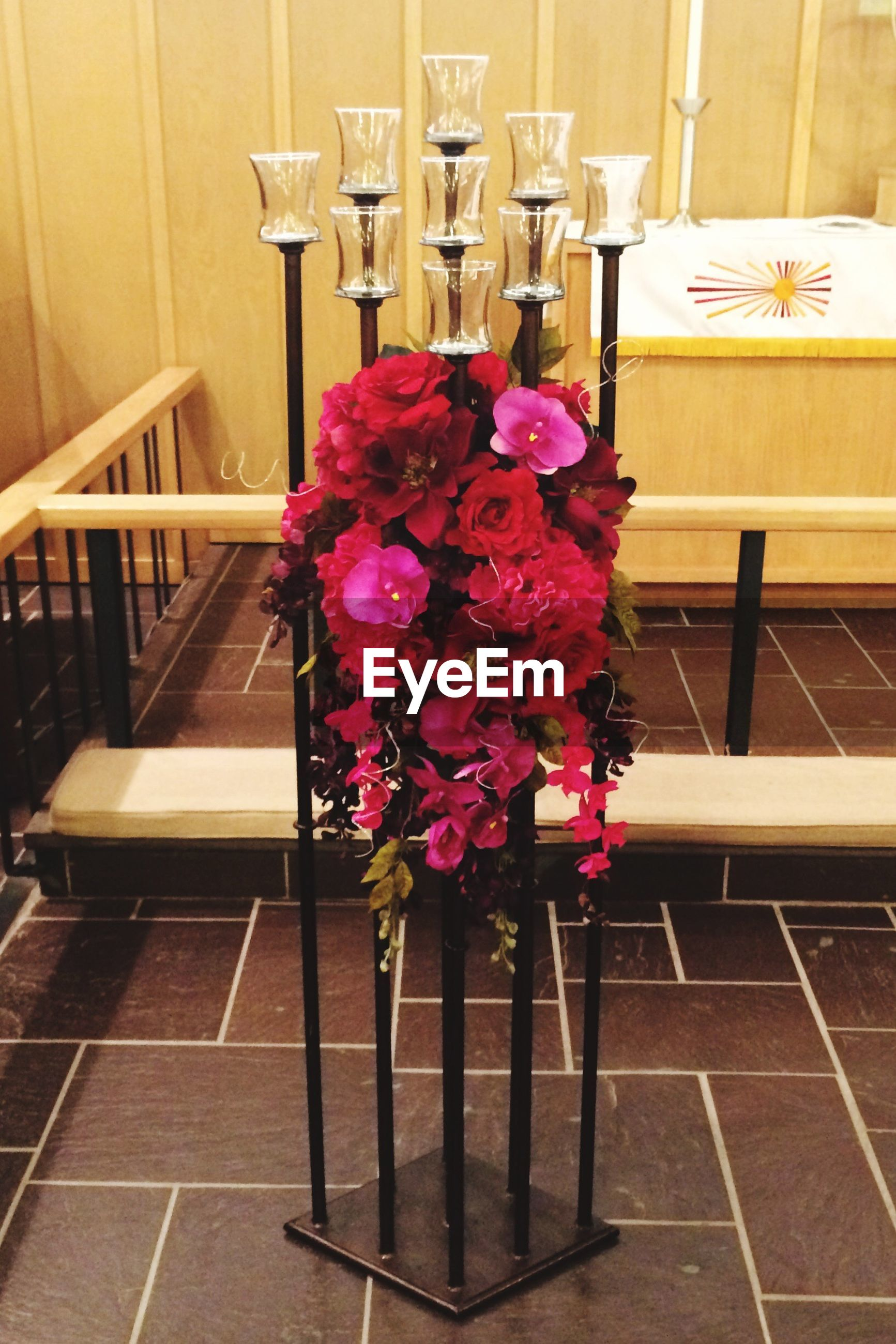 flower, indoors, freshness, petal, fragility, vase, table, potted plant, flower head, flower pot, pink color, wood - material, high angle view, plant, growth, beauty in nature, chair, no people, nature, flower arrangement