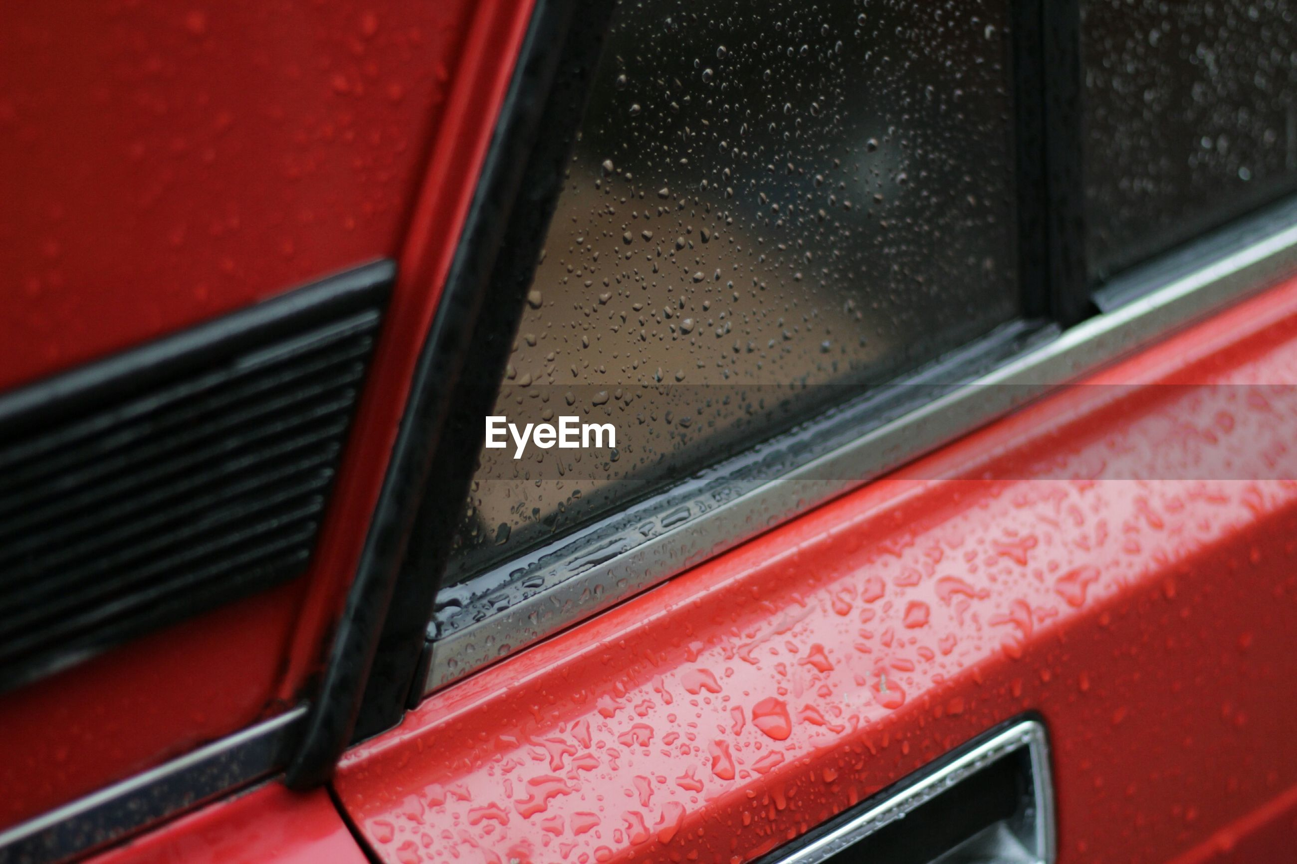 Close-up of raindrops on car