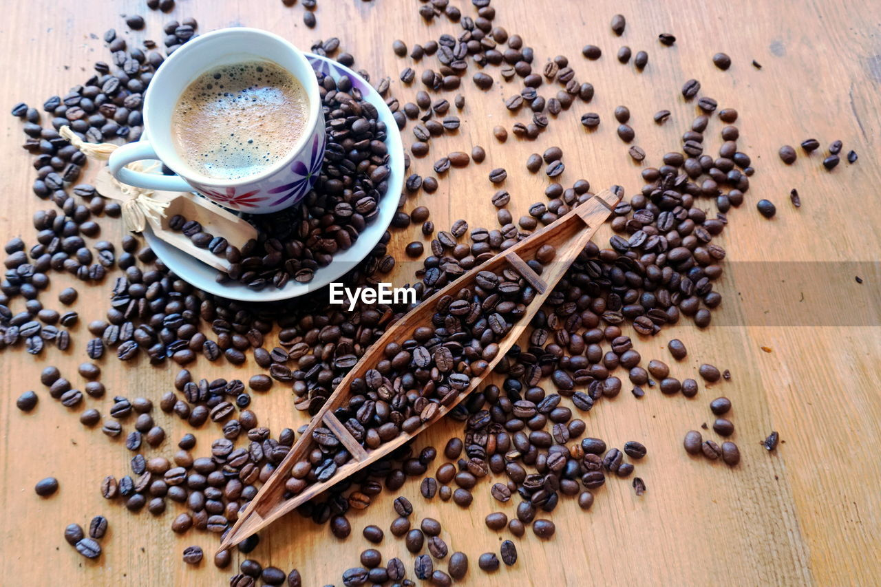 food and drink, coffee, coffee - drink, drink, refreshment, cup, coffee cup, mug, table, freshness, roasted coffee bean, still life, food, high angle view, indoors, saucer, crockery, spoon, large group of objects, kitchen utensil, no people, hot drink, non-alcoholic beverage, caffeine