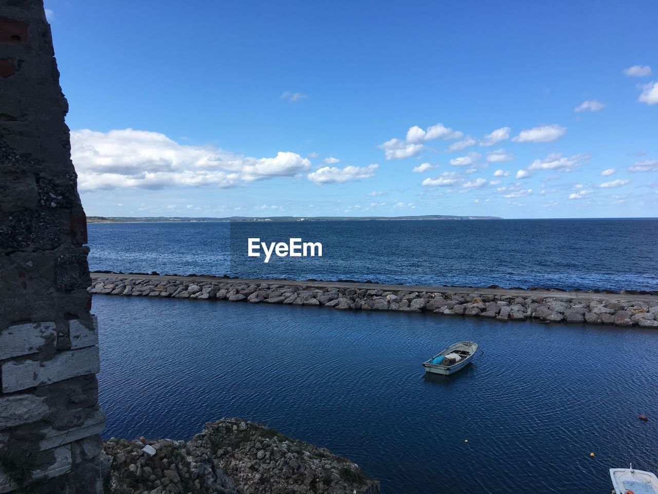 water, sea, sky, cloud - sky, scenics - nature, horizon, beauty in nature, tranquil scene, blue, horizon over water, tranquility, nature, day, no people, rock, idyllic, outdoors, solid, non-urban scene, groyne