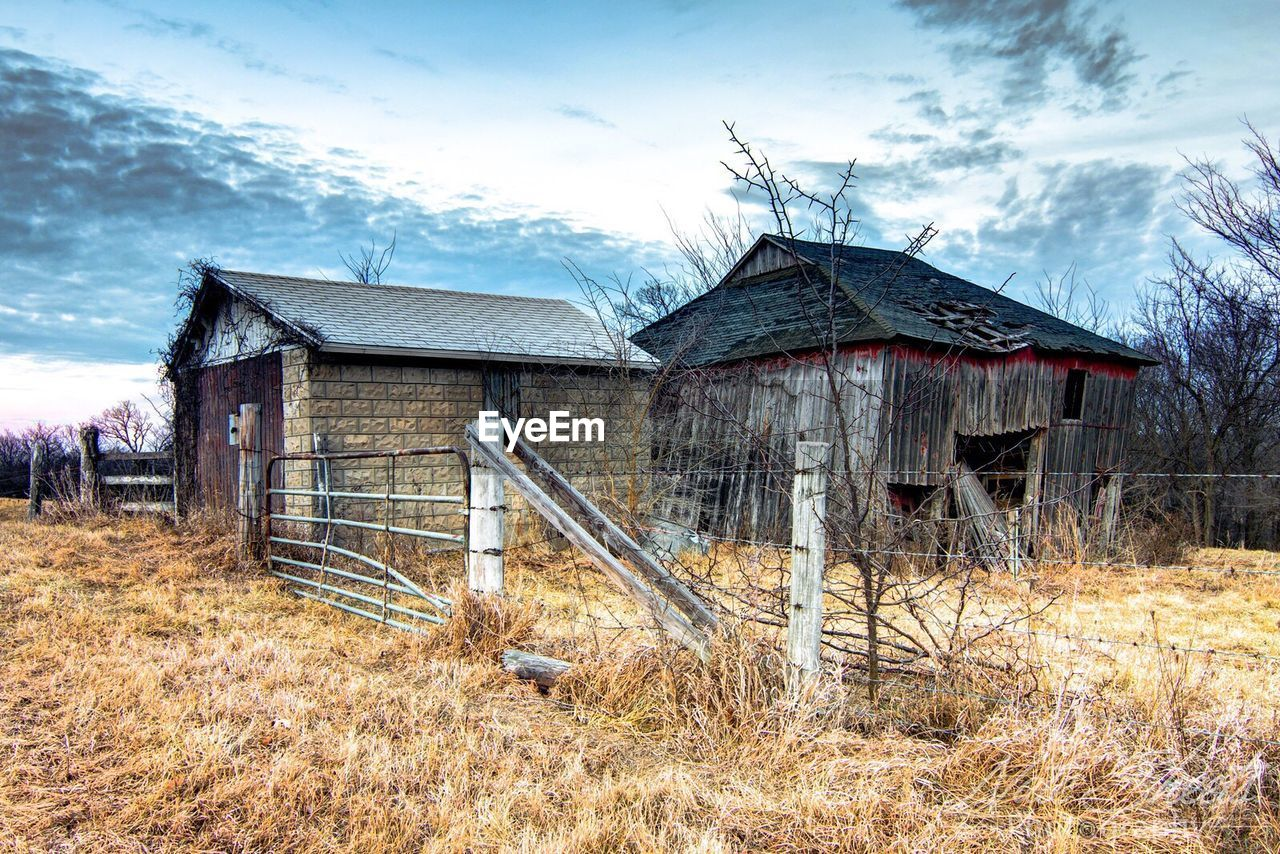 built structure, architecture, abandoned, building exterior, sky, house, no people, run-down, damaged, outdoors, bad condition, day, cloud - sky, grass, bare tree, nature, tree