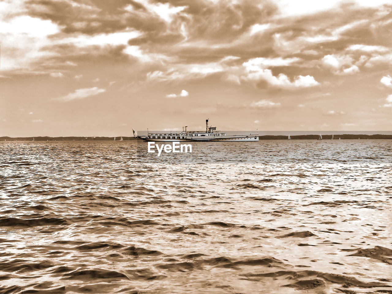 sky, water, nautical vessel, cloud - sky, sea, transportation, mode of transportation, scenics - nature, beauty in nature, waterfront, tranquility, nature, tranquil scene, no people, travel, non-urban scene, outdoors, beach, day, anchored