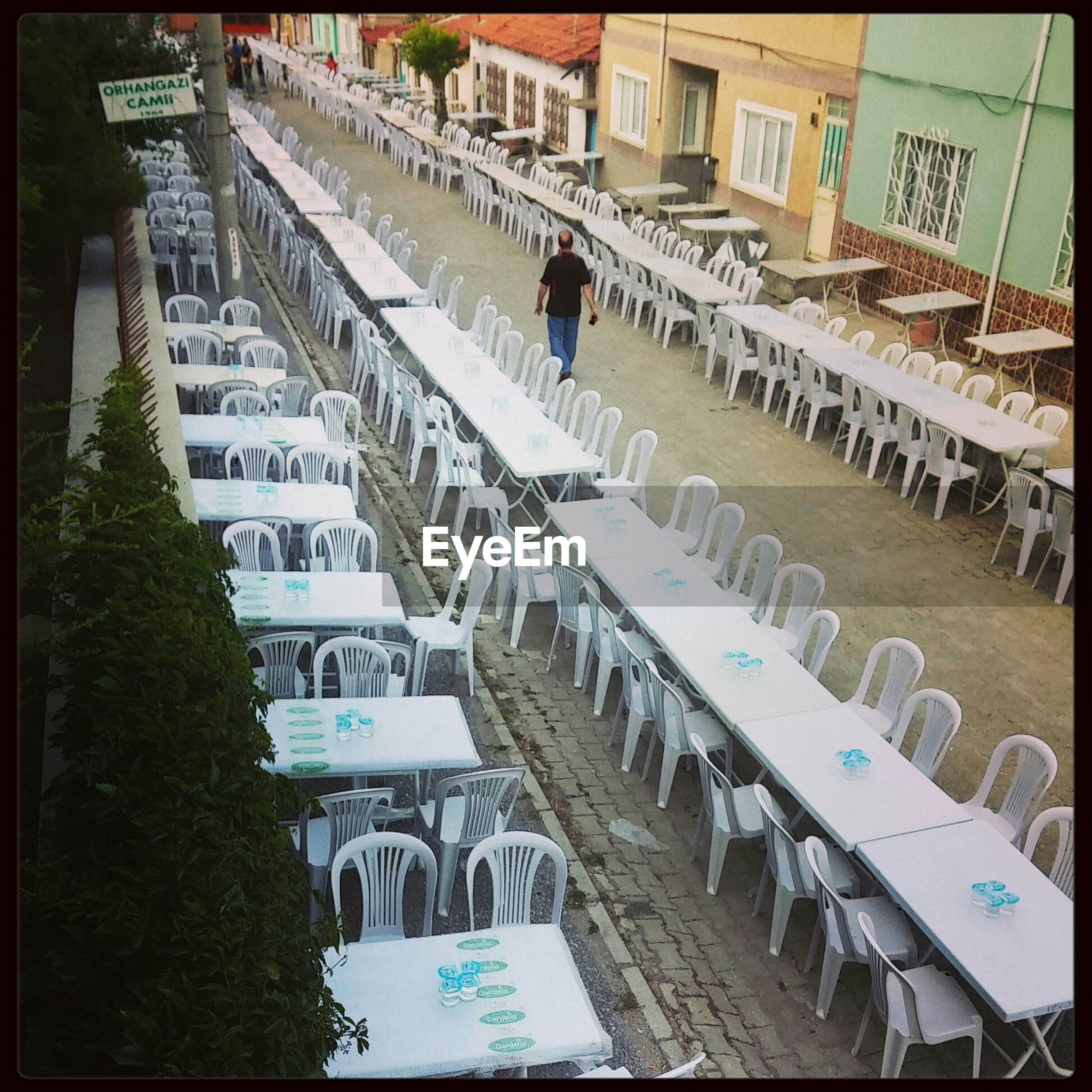 Empty chairs and tables in rows