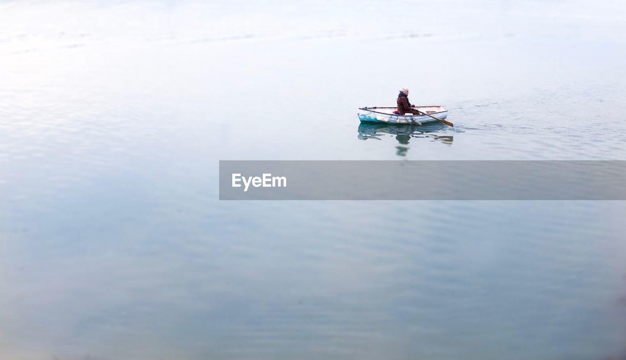 MEN ON BOAT IN SEA