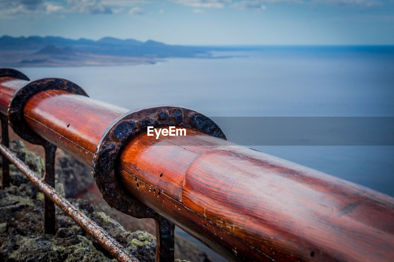 water, metal, no people, focus on foreground, nature, day, wood - material, close-up, sea, sky, rusty, outdoors, land, old, beach, pipe - tube, cylinder, selective focus, container