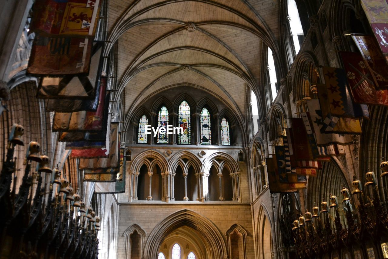 architecture, place of worship, arch, religion, belief, built structure, spirituality, building, indoors, no people, the past, history, travel destinations, day, architectural column, low angle view, ceiling, glass, gothic style, abbey, ornate