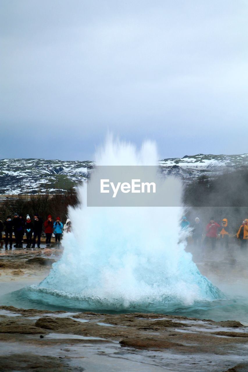 geyser, power in nature, hot spring, water, motion, steam, outdoors, nature, tourism, heat - temperature, beauty in nature, erupting, travel destinations, day, spraying, sky, no people