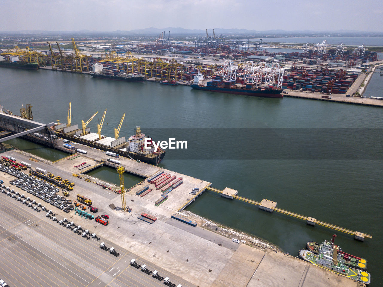 transportation, water, nautical vessel, high angle view, mode of transportation, architecture, day, building exterior, harbor, built structure, river, freight transportation, nature, city, industry, shipping, travel, outdoors, ship, no people, cityscape