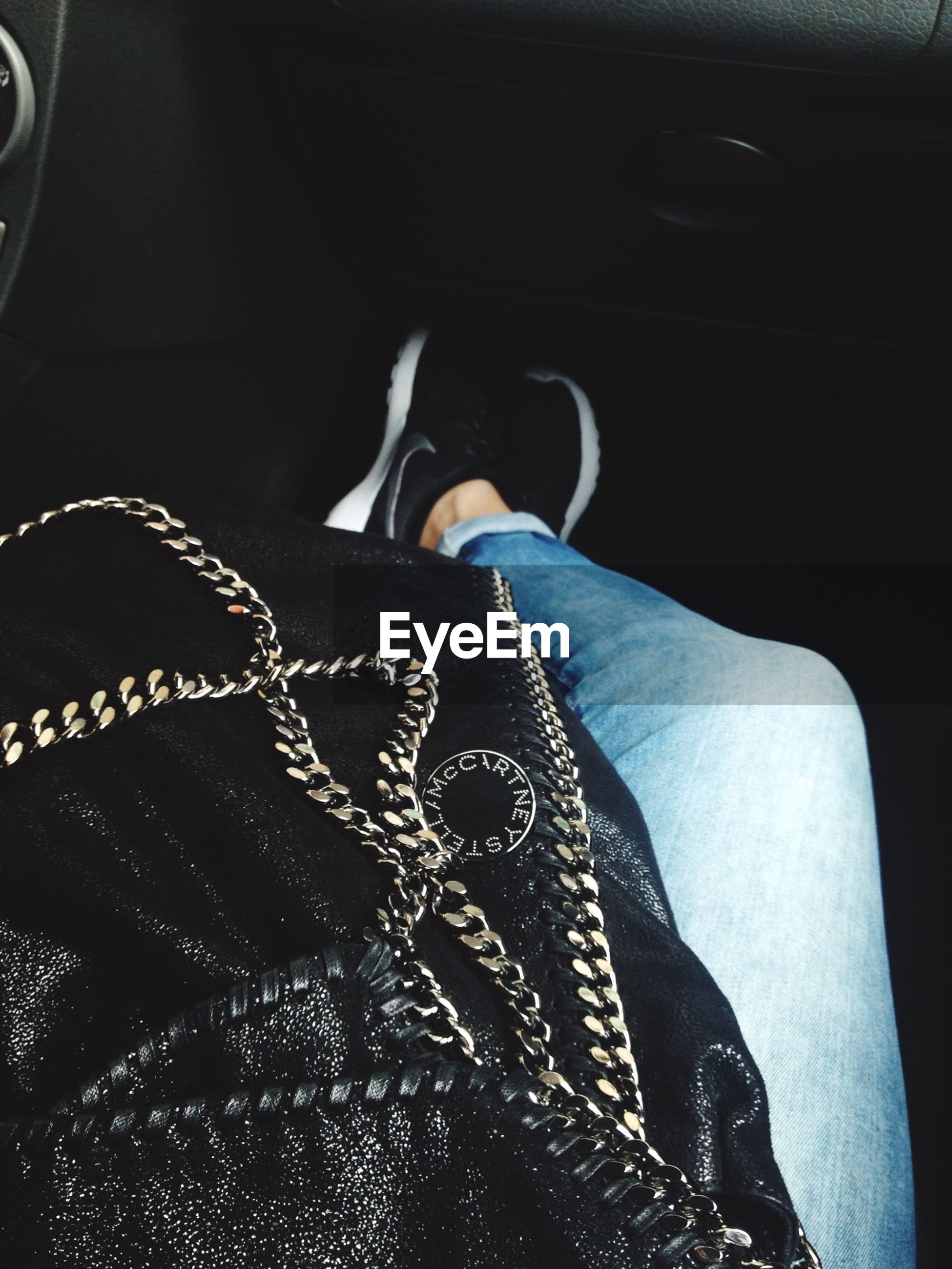 person, low section, personal perspective, jeans, shoe, part of, close-up, fashion, indoors, lifestyles, car, high angle view, land vehicle, textile, human foot, footwear, midsection