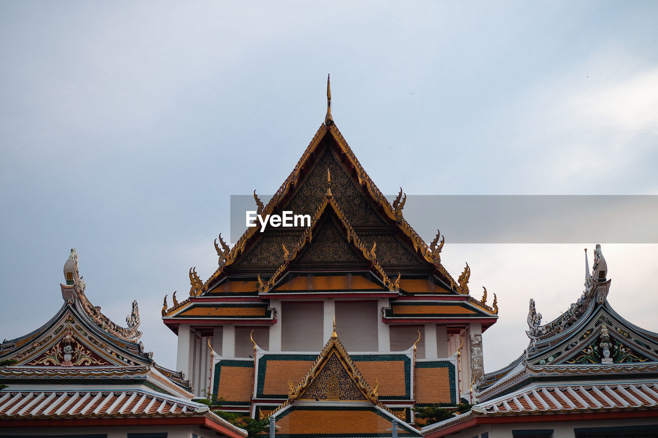 religion, architecture, belief, built structure, place of worship, spirituality, building, building exterior, sky, day, roof, nature, no people, low angle view, cloud - sky, outdoors, high section, travel destinations, spire, ornate