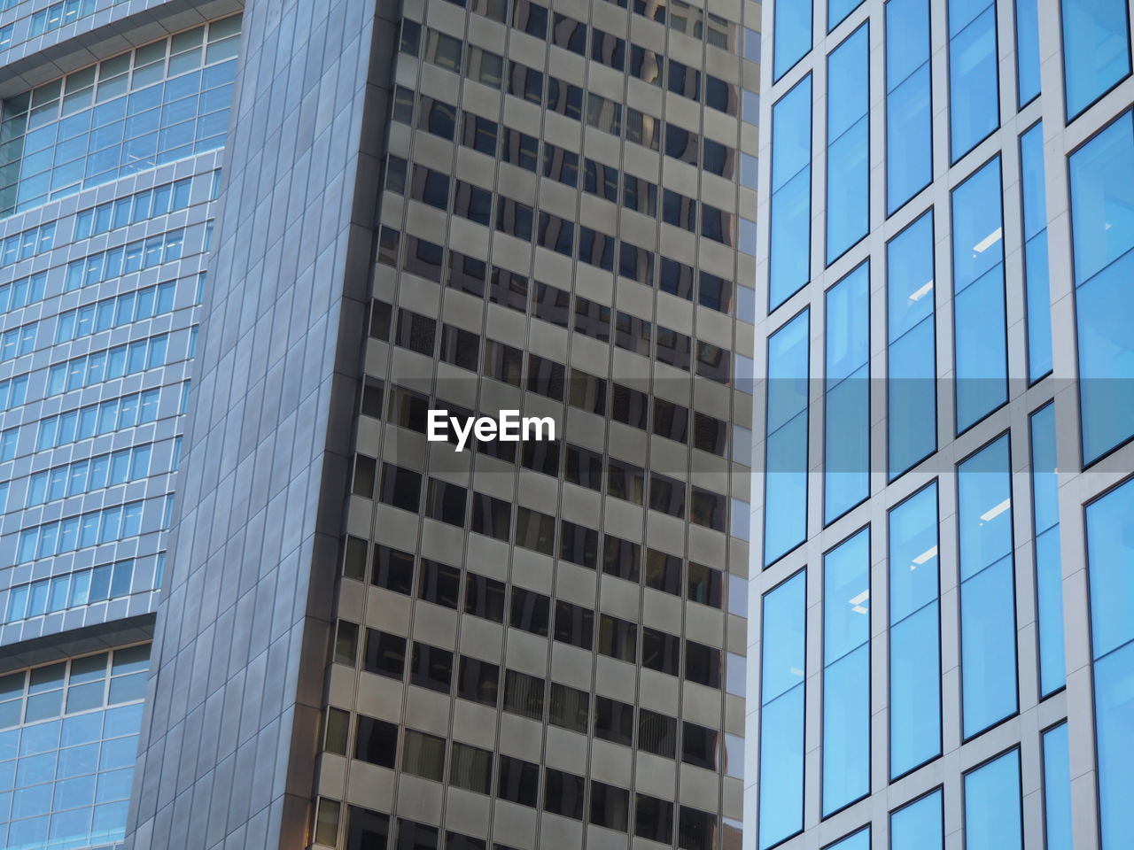 architecture, modern, building exterior, built structure, glass - material, window, low angle view, skyscraper, office building exterior, day, pattern, blue, no people, outdoors, city, growth, corporate business, sky