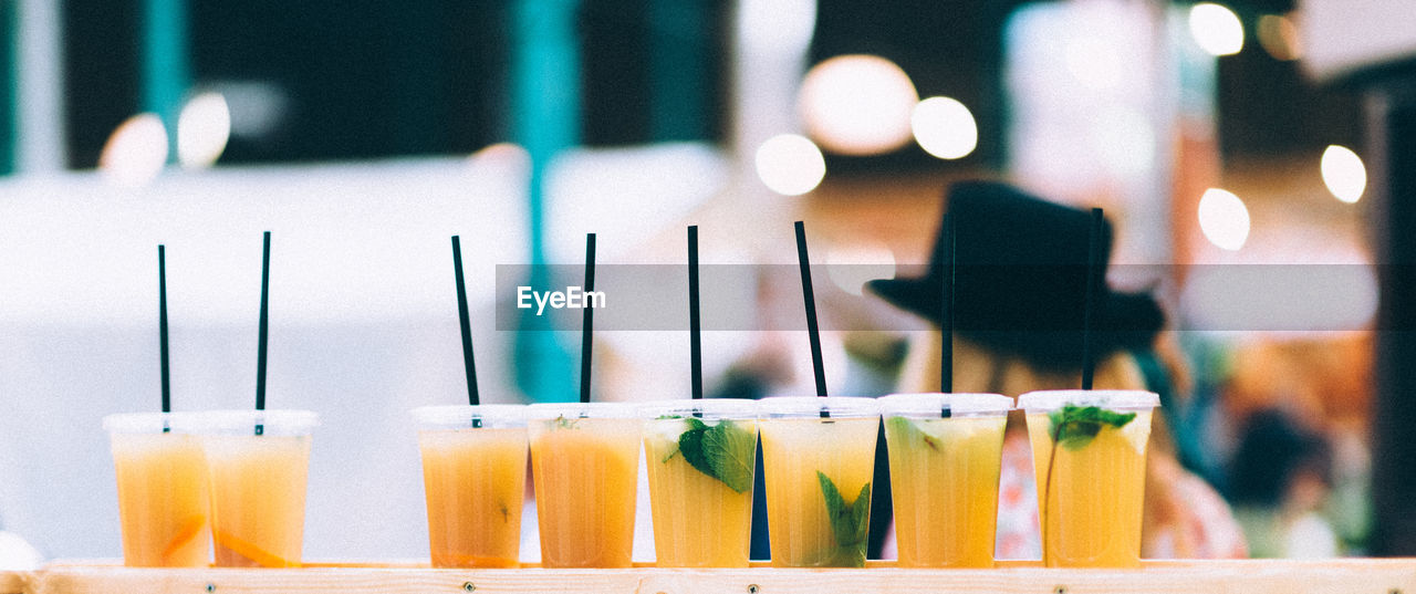 Close up of drinks in disposable glasses