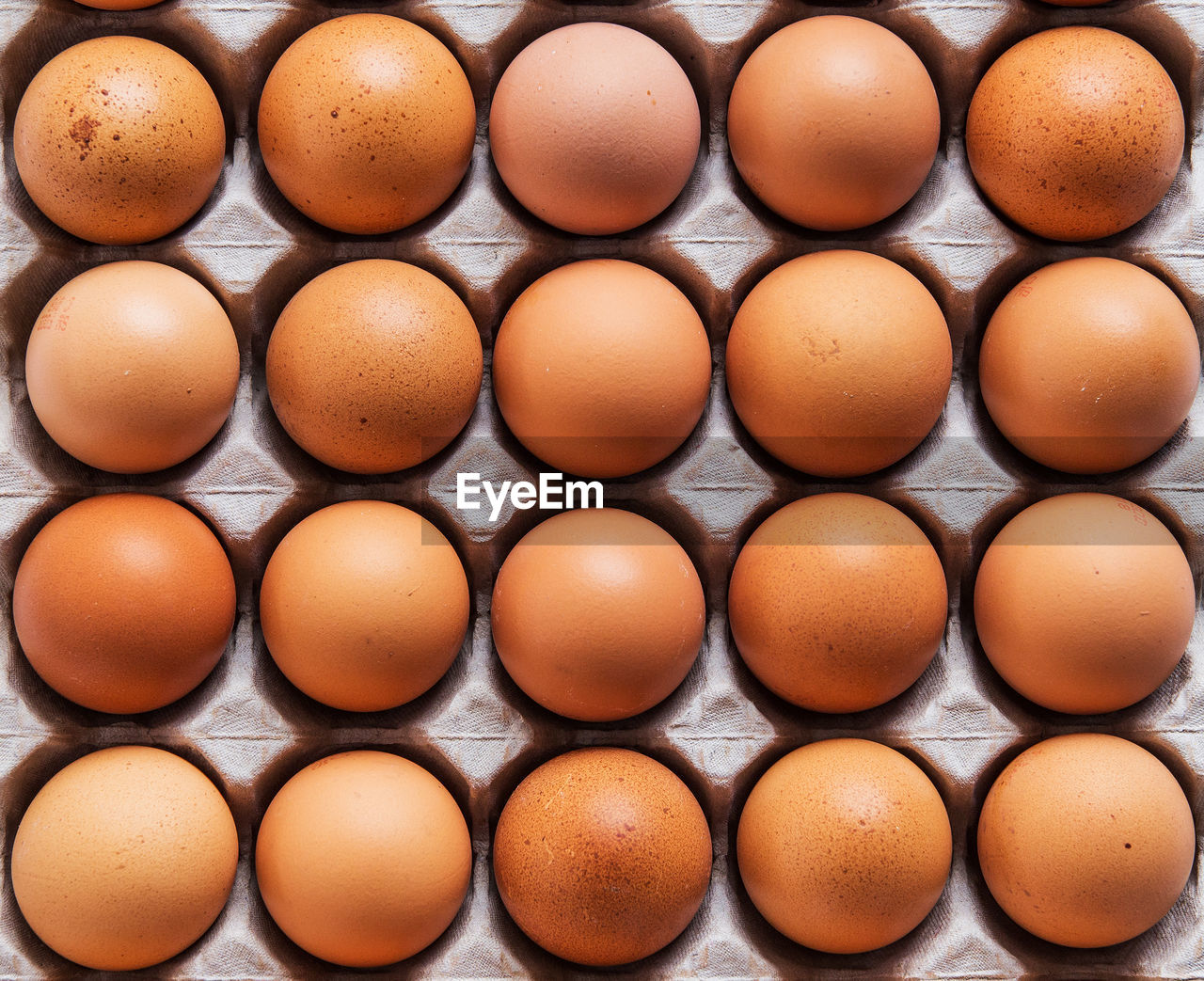 egg, wellbeing, food and drink, freshness, large group of objects, healthy eating, in a row, food, arrangement, directly above, no people, brown, full frame, side by side, egg carton, backgrounds, raw food, indoors, still life, order, carton, breakfast