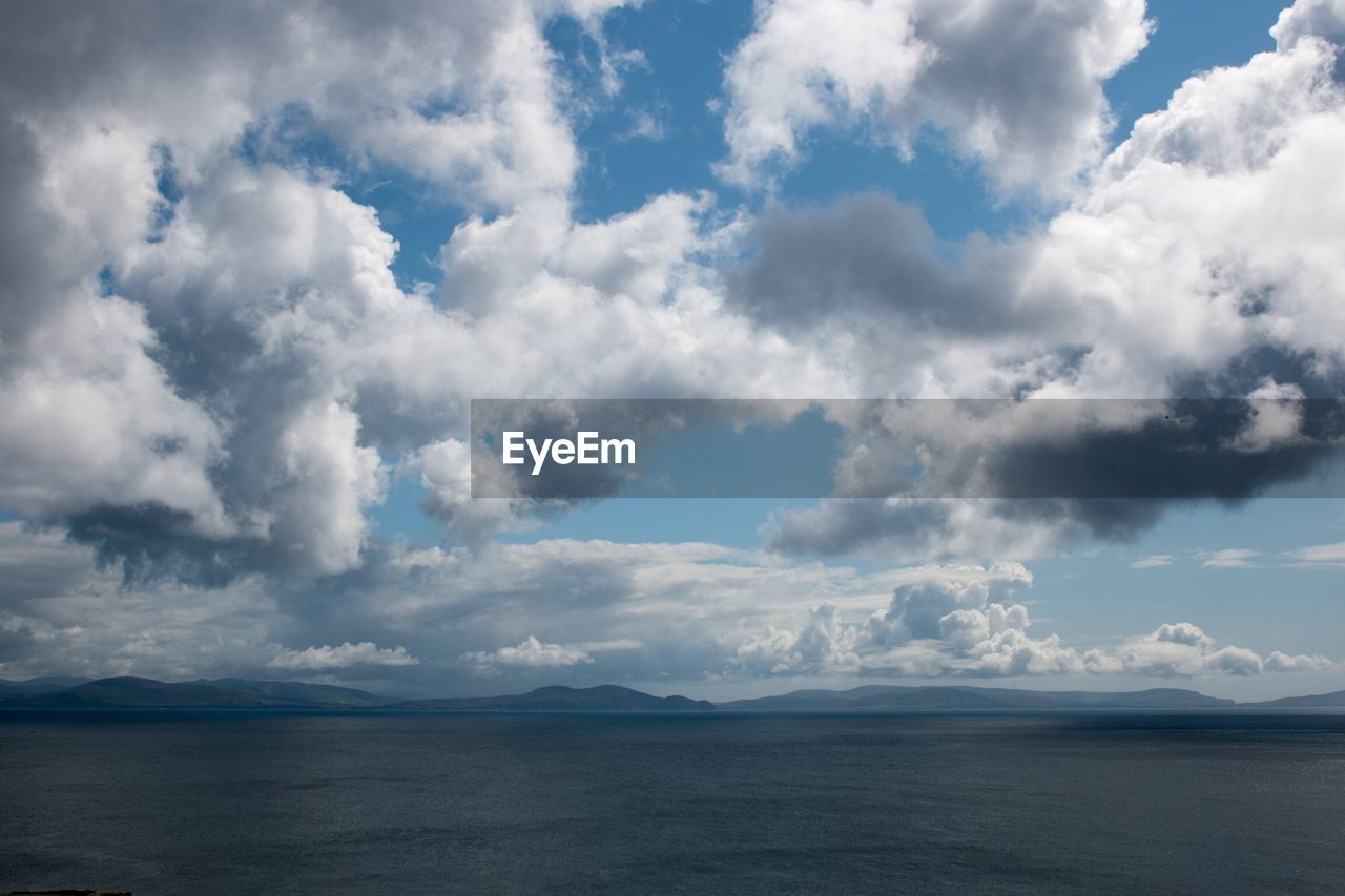Cloudscape over mountains and sea
