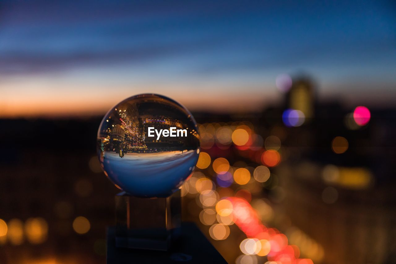 Close-Up Of Crystal Ball Against Sky At Night