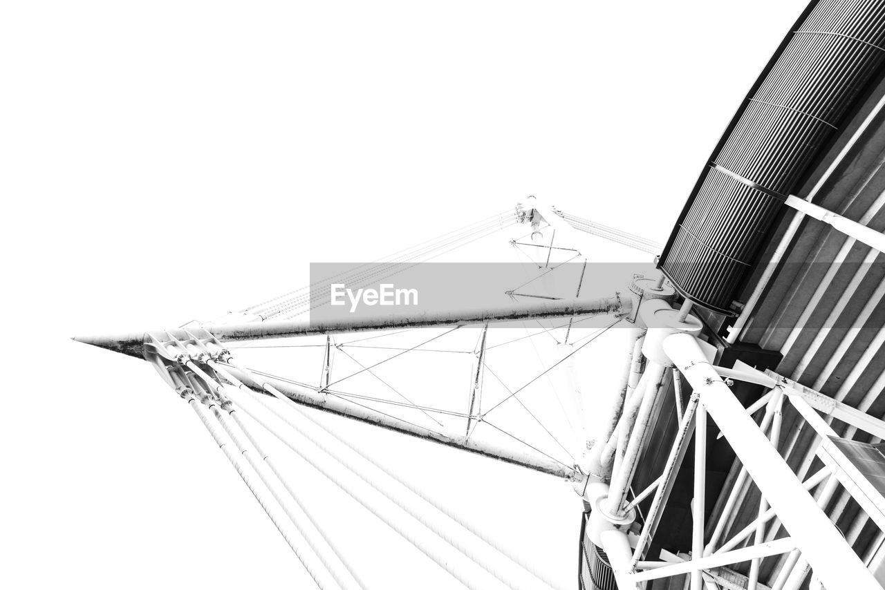 sky, low angle view, clear sky, nature, no people, day, amusement park ride, built structure, architecture, amusement park, arts culture and entertainment, metal, copy space, outdoors, fuel and power generation, transportation, ferris wheel, tall - high, mode of transportation, alternative energy, steel, fairground