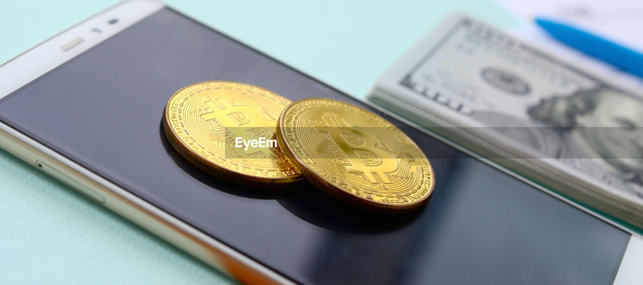 finance, currency, wealth, business, coin, no people, close-up, still life, metal, indoors, investment, number, focus on foreground, high angle view, gold colored, text, table, communication, finance and economy, economy