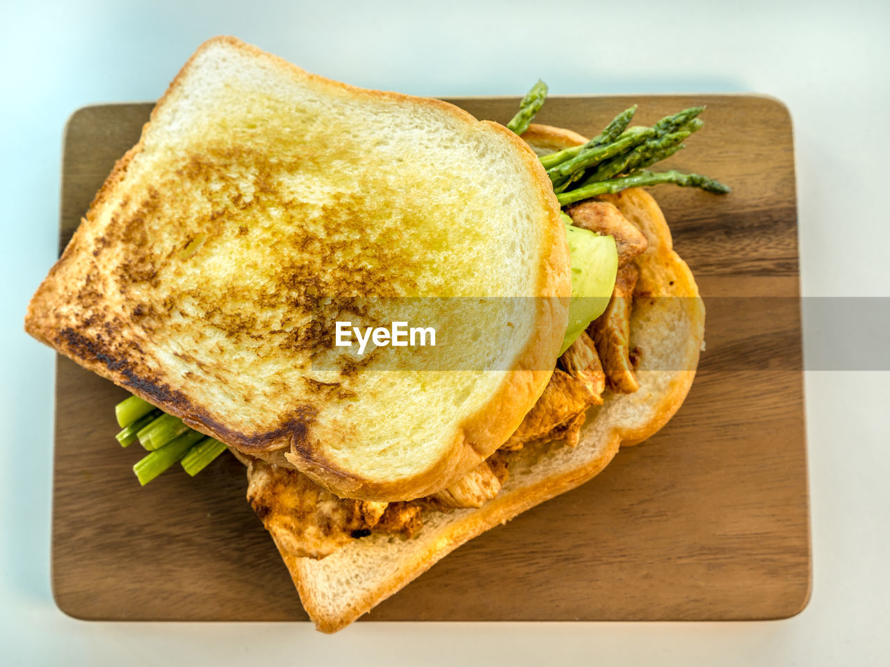 food, food and drink, bread, freshness, ready-to-eat, sandwich, indoors, still life, wellbeing, close-up, healthy eating, vegetable, no people, table, snack, cutting board, high angle view, serving size, toasted bread, plate, breakfast
