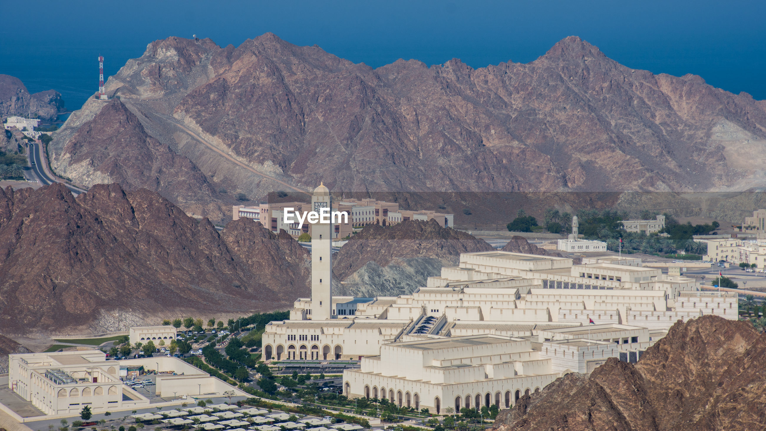 Oman parliament buildings in city against mountain range