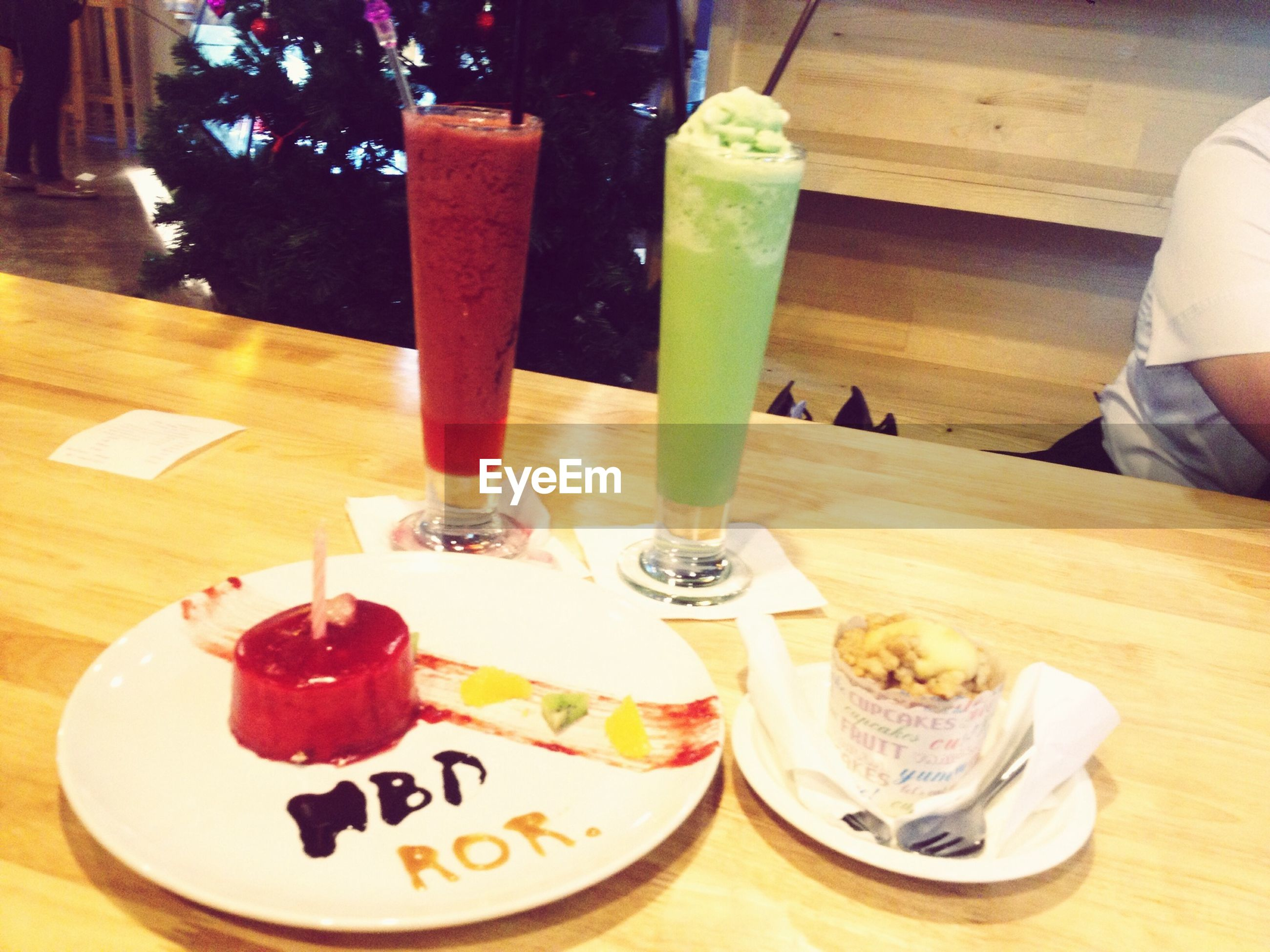 food and drink, table, indoors, freshness, food, drink, still life, plate, drinking glass, ready-to-eat, refreshment, sweet food, indulgence, wood - material, restaurant, dessert, healthy eating, serving size, fruit, strawberry