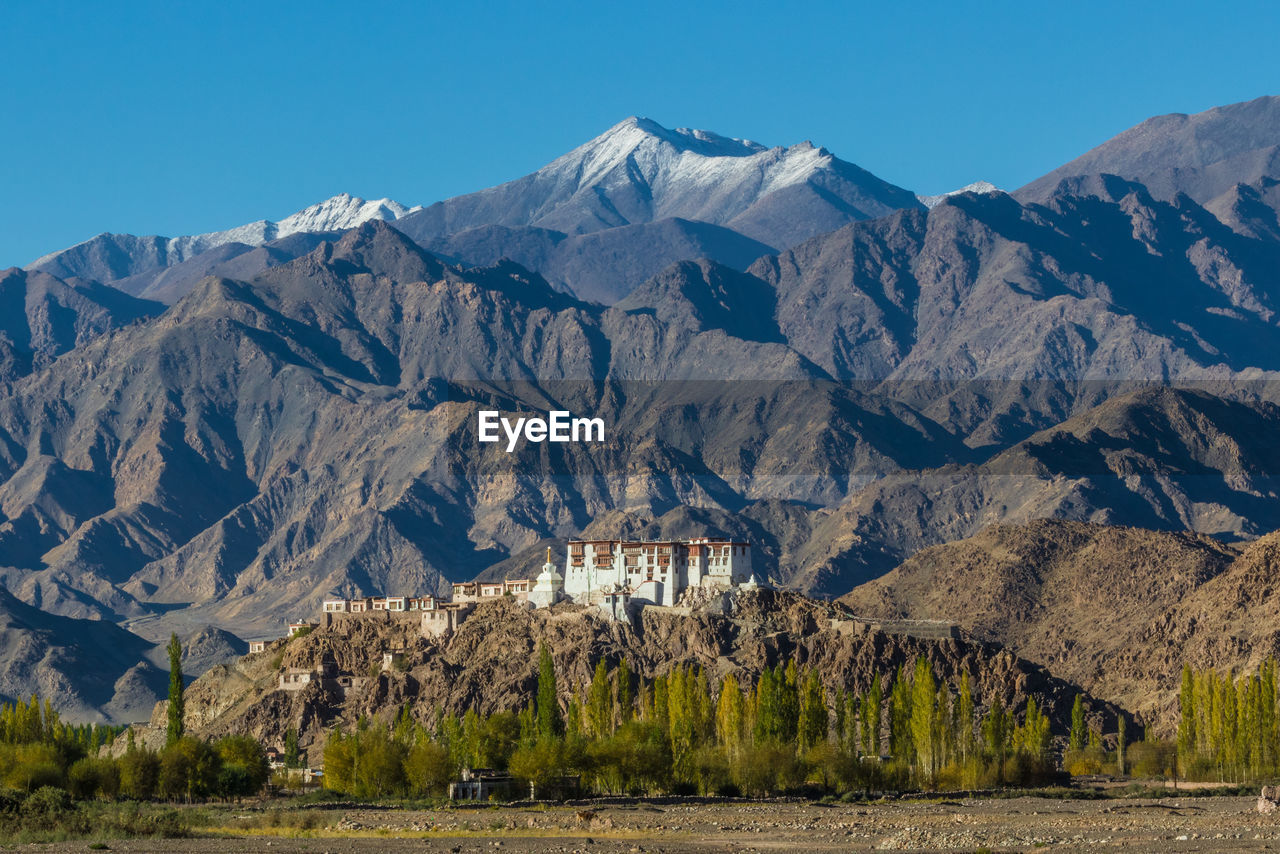mountain, mountain range, scenics - nature, sky, beauty in nature, nature, environment, no people, landscape, architecture, rock, non-urban scene, tranquil scene, day, clear sky, tranquility, land, physical geography, built structure, geology, outdoors, mountain peak, snowcapped mountain, formation