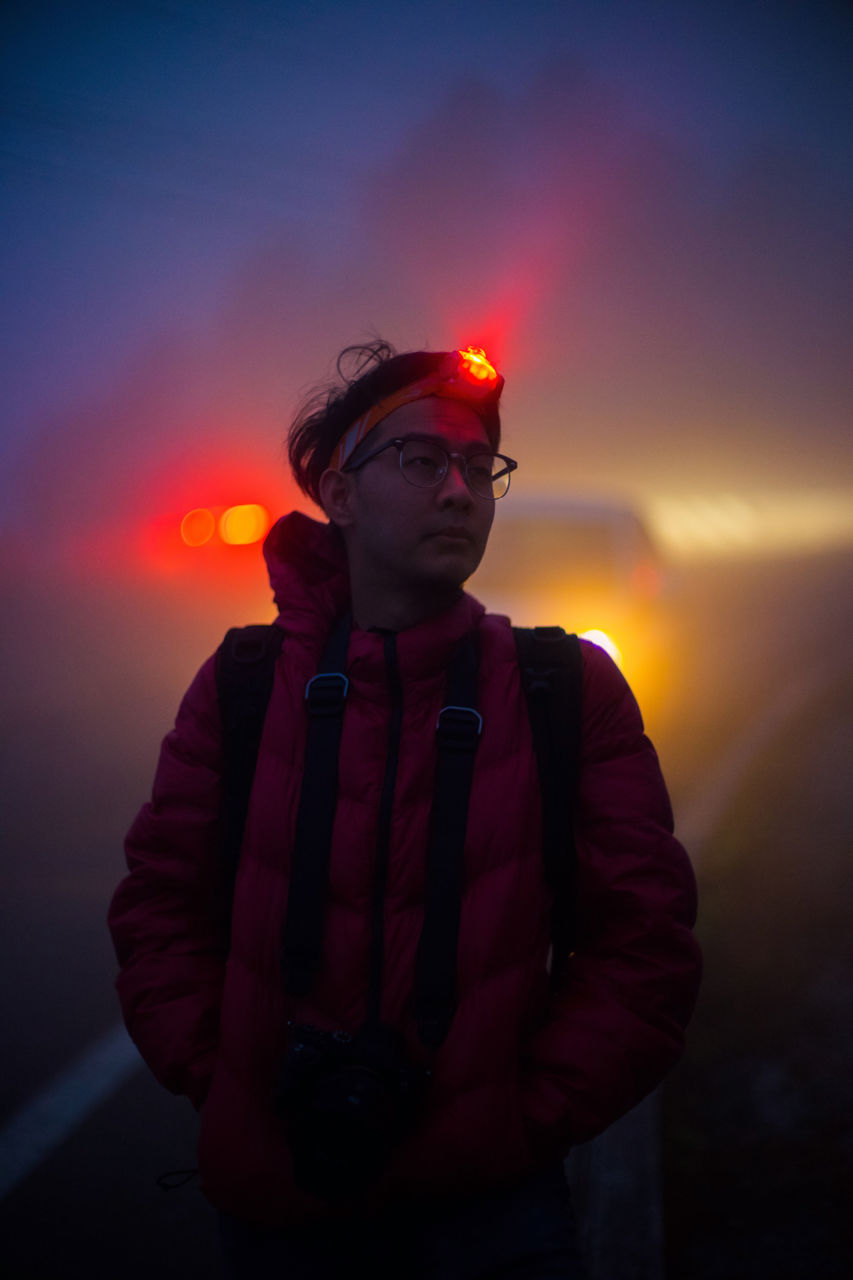 Man With Illuminated Headlamp During Foggy Weather At Night