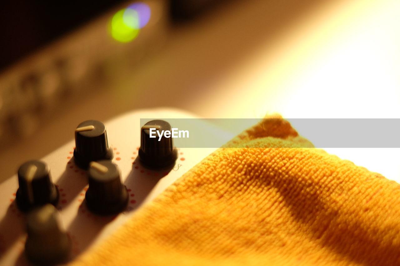 High angle view of napkin on sound mixer