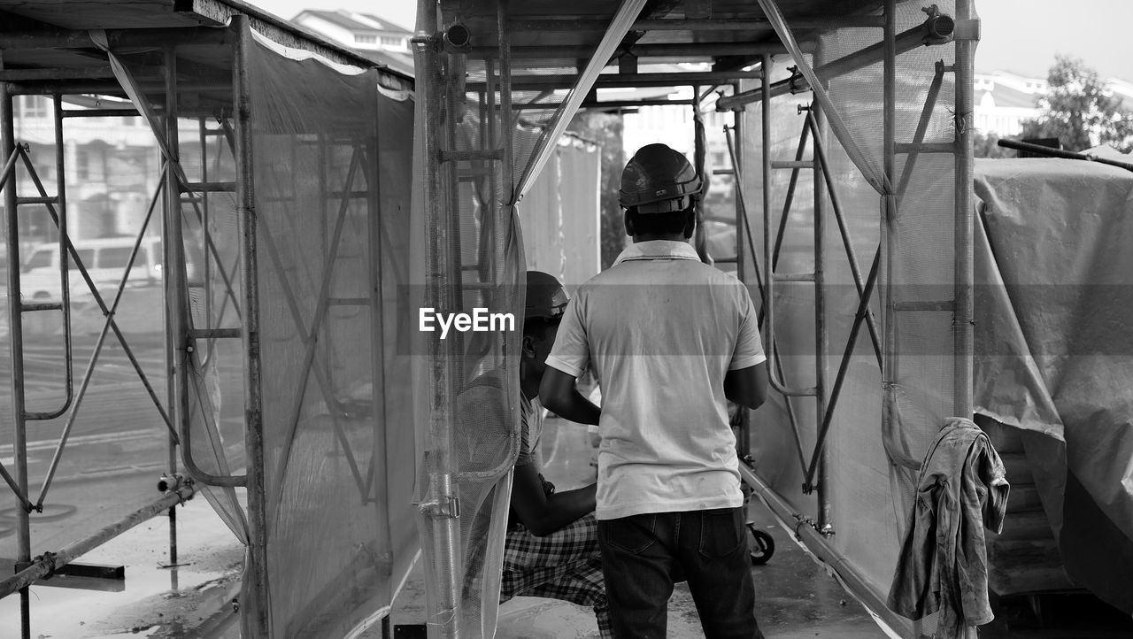 Rear View Of Man Working