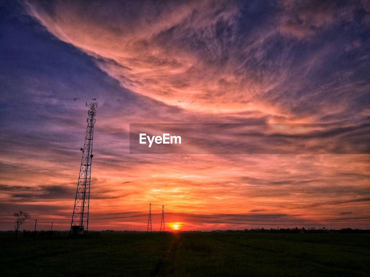 sky, sunset, cloud - sky, technology, orange color, electricity, beauty in nature, electricity pylon, connection, nature, fuel and power generation, scenics - nature, no people, low angle view, silhouette, power line, land, cable, field, power supply, outdoors, global communications