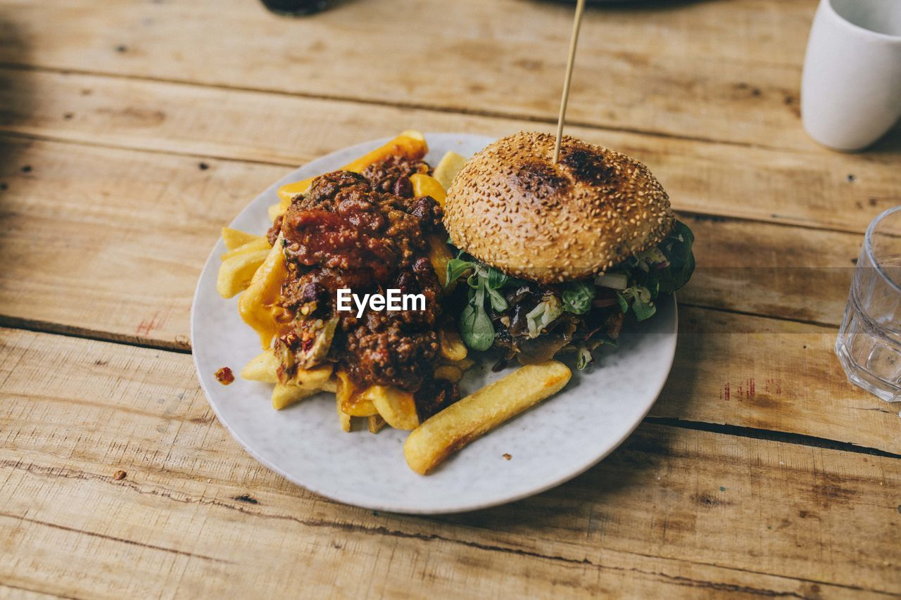 Close-Up Of Hamburger And French Fries Served In Plate On Table