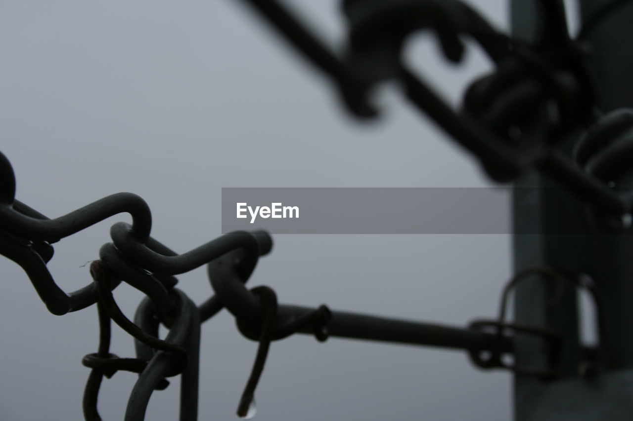 metal, security, protection, safety, close-up, barbed wire, focus on foreground, no people, outdoors, day, sky, low angle view, clear sky, wrought iron