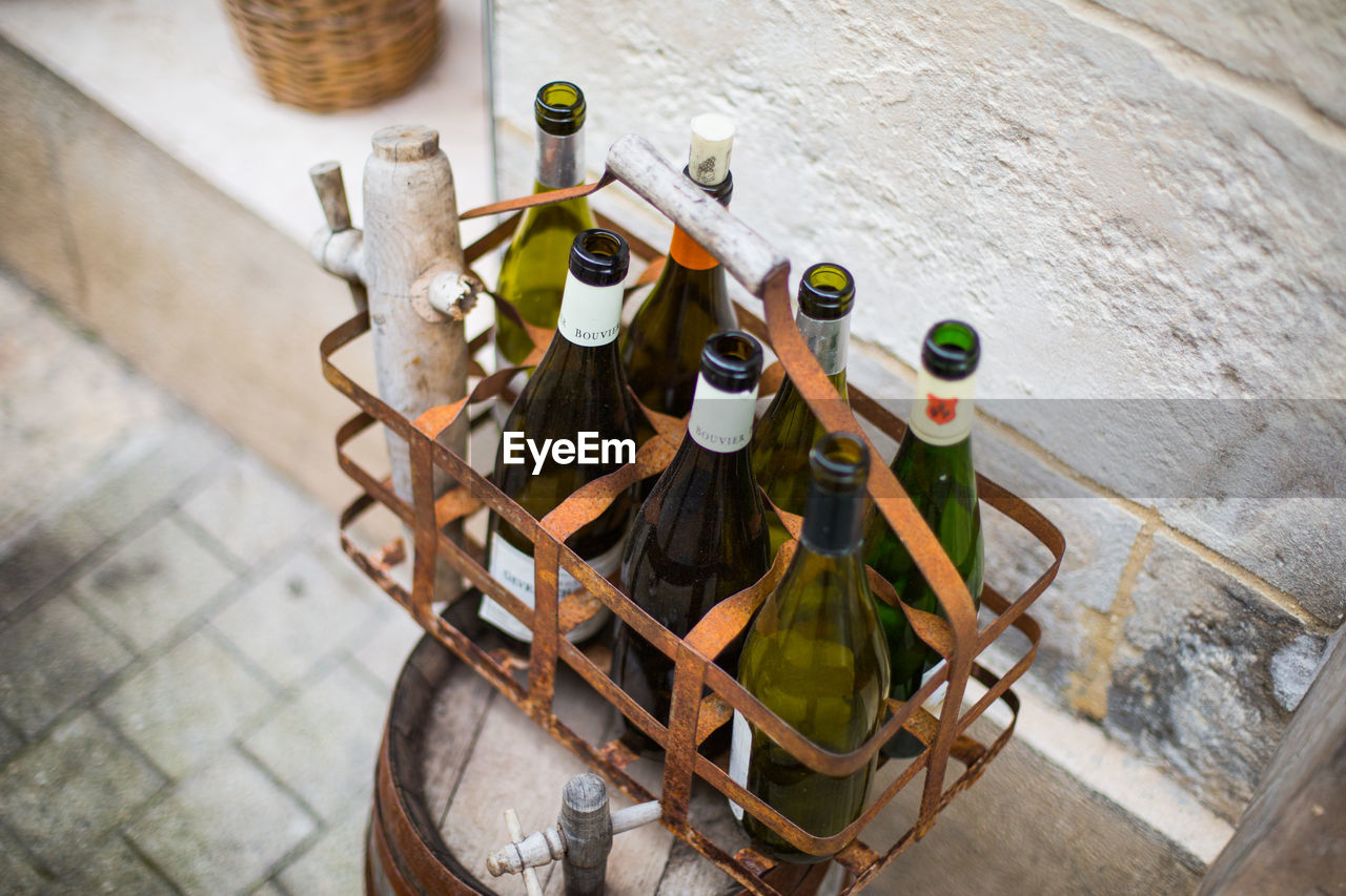 High Angle View Of Wine Bottles In Metal Crate