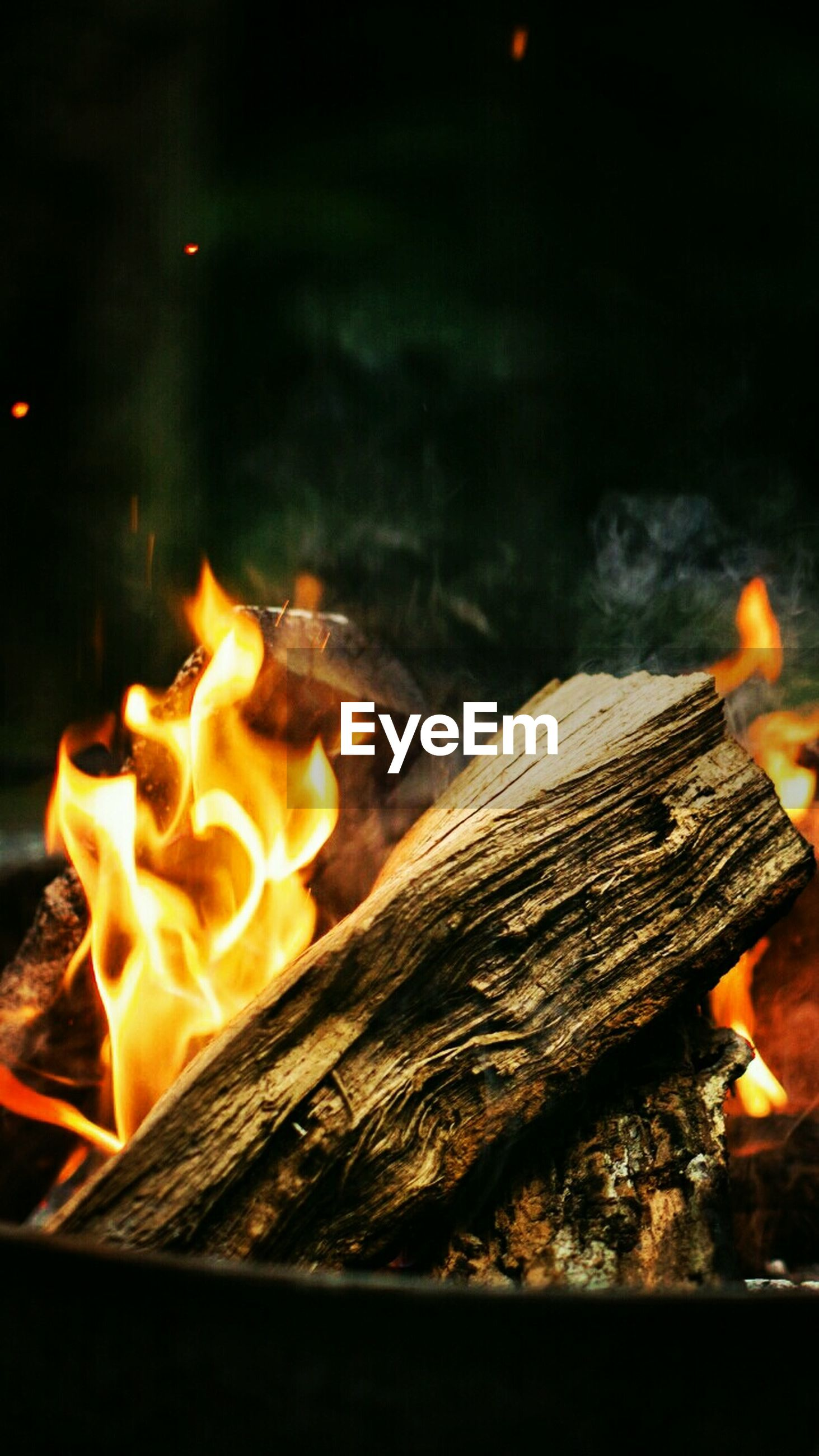 fire - natural phenomenon, burning, flame, heat - temperature, wood - material, glowing, close-up, night, no people, campfire, bonfire, outdoors, motion, fire pit, nature