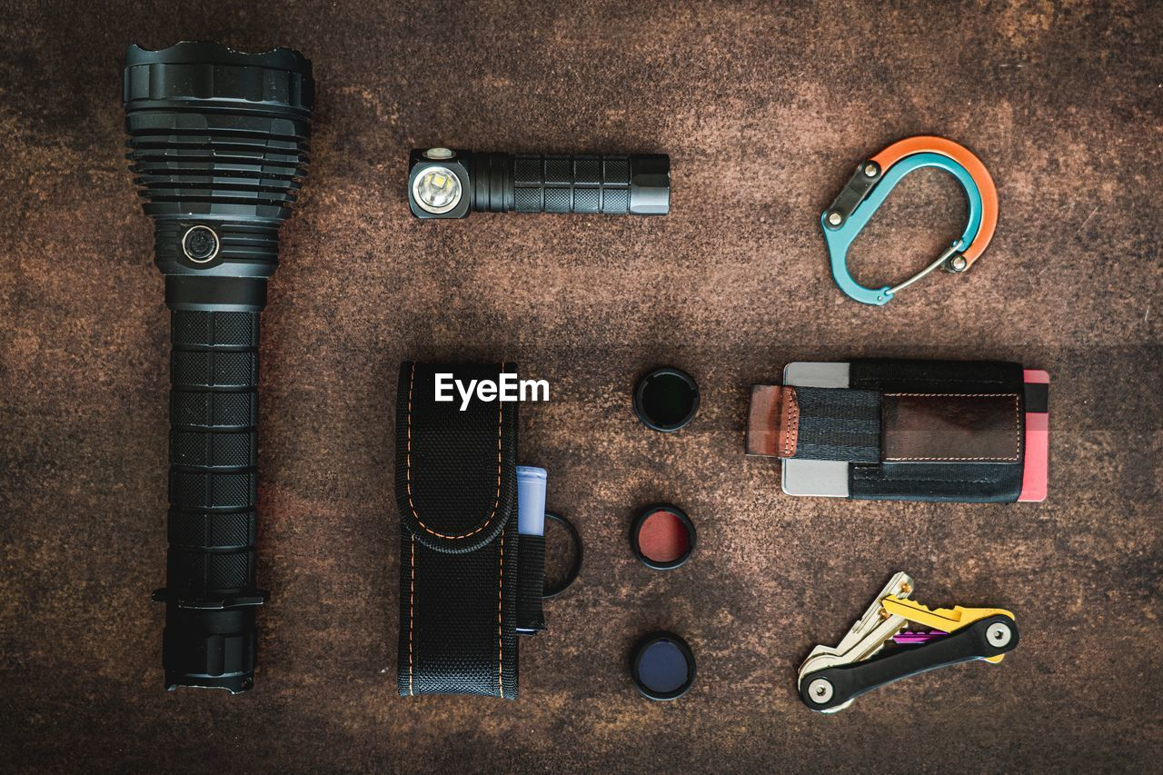 HIGH ANGLE VIEW OF OBJECTS ON TABLE AGAINST GRAY BACKGROUND