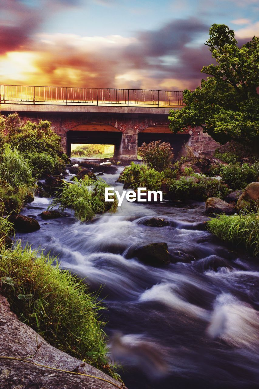 bridge - man made structure, connection, river, architecture, water, built structure, long exposure, motion, nature, outdoors, no people, sky, cloud - sky, bridge, growth, day, tree, waterfall, beauty in nature