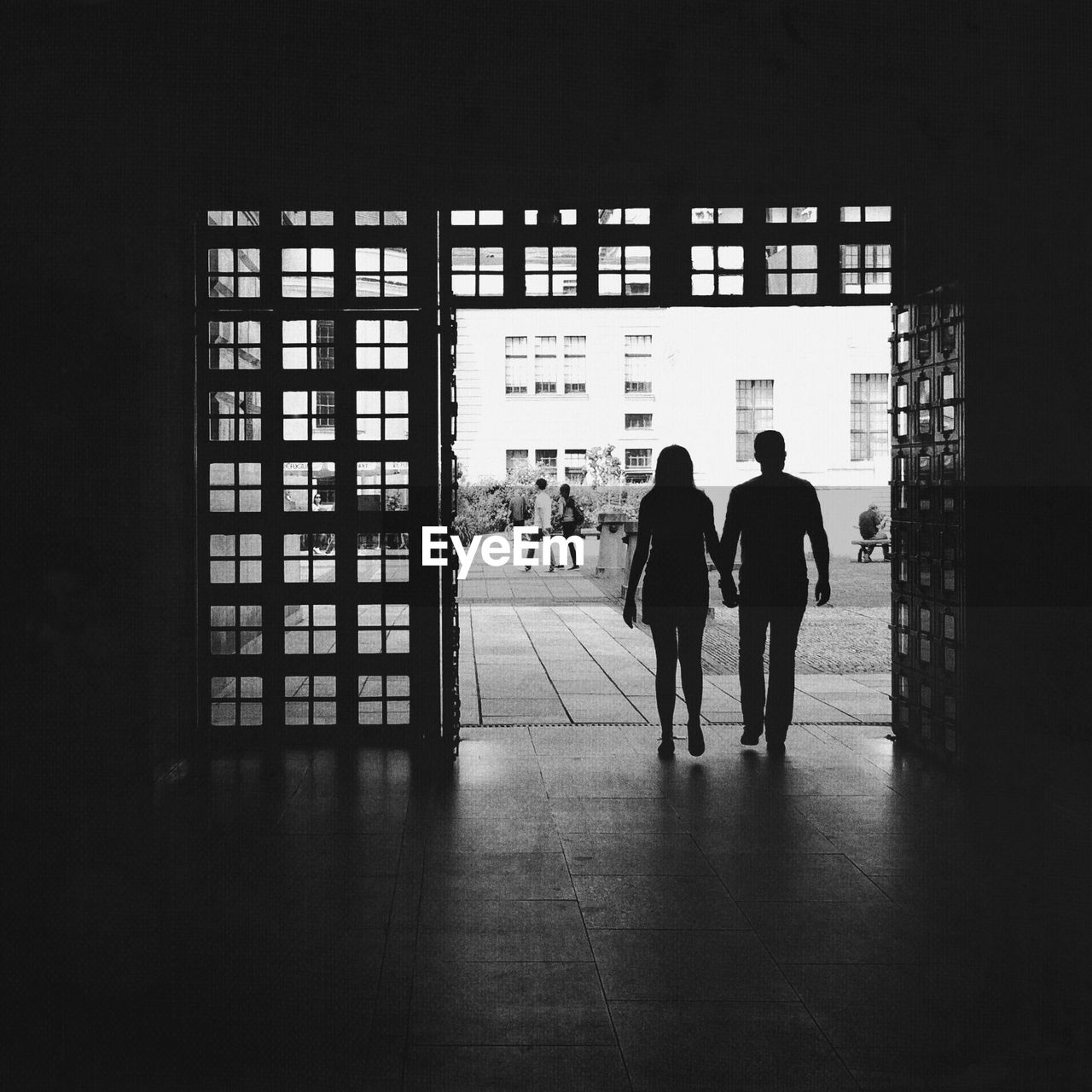 Rear view of silhouette couple holding hands