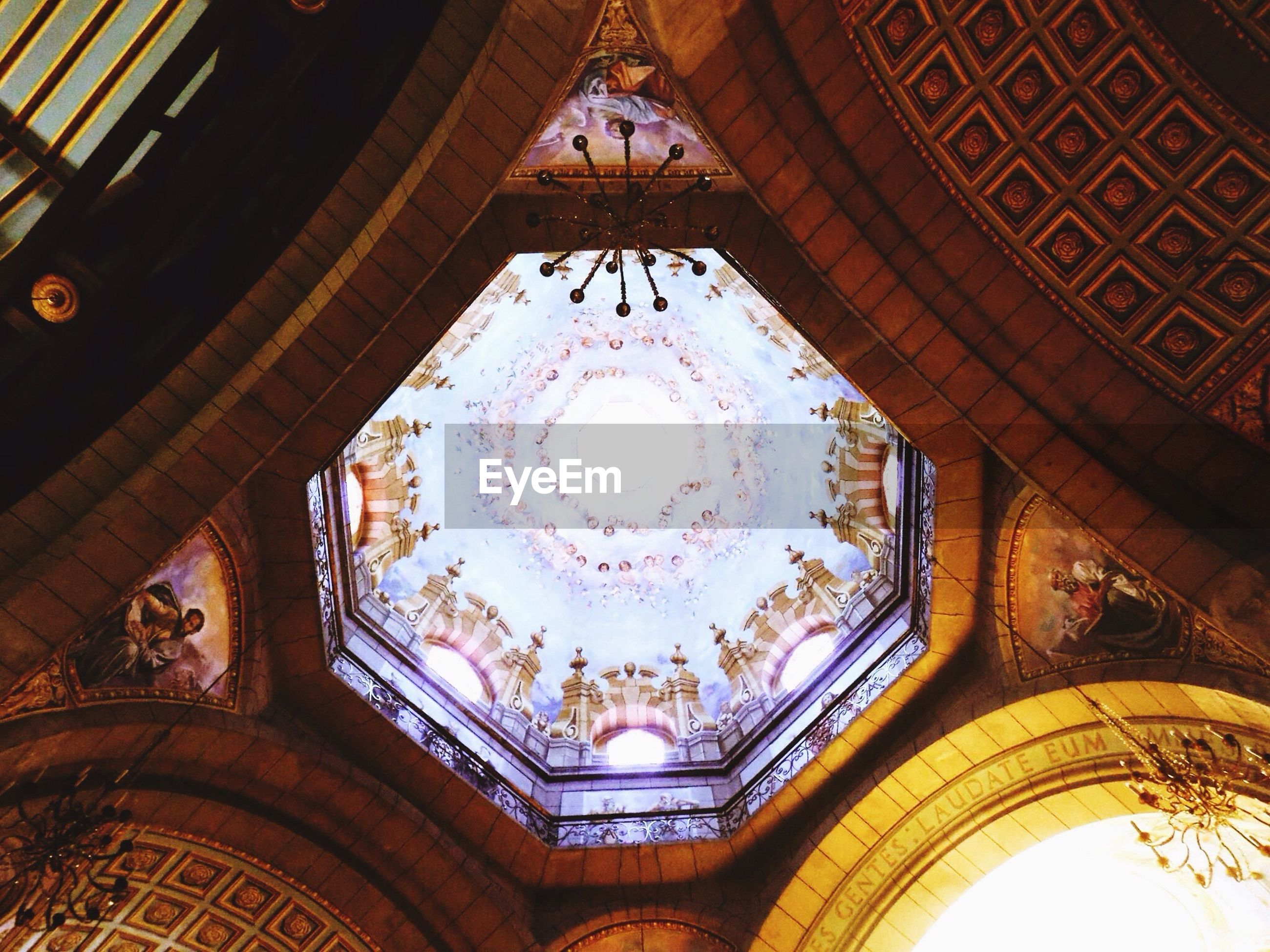 indoors, ceiling, low angle view, architecture, built structure, place of worship, religion, ornate, chandelier, spirituality, church, design, directly below, architectural feature, illuminated, pattern, cathedral, famous place