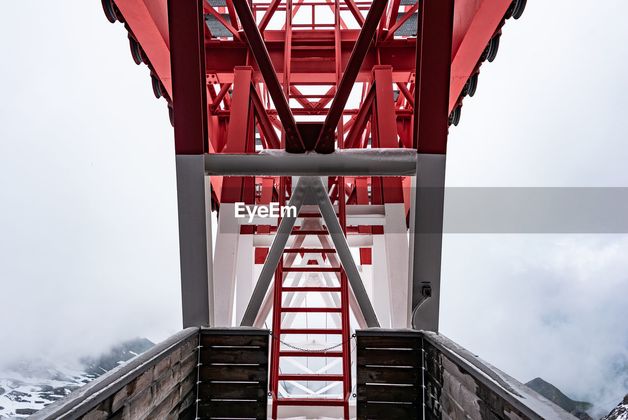 Pylon, red and white painted steel tower, fragments showing details of construction, joins, rivets.