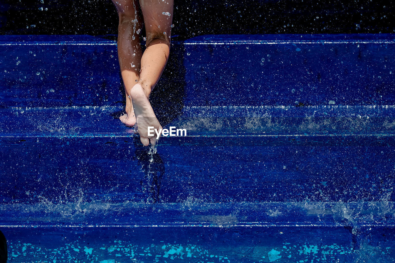 Woman Walking On Steps In Pool